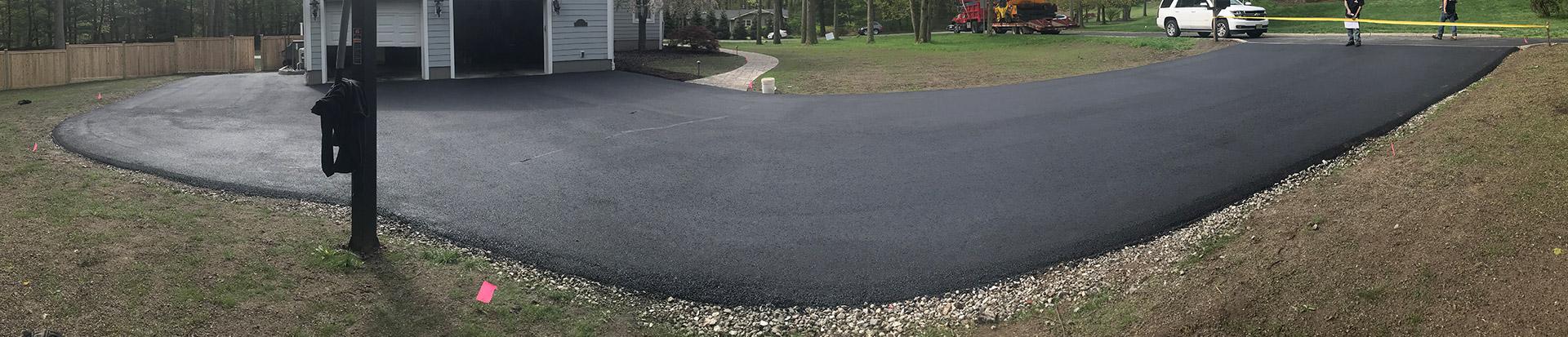 home driveway with fresh asphalt