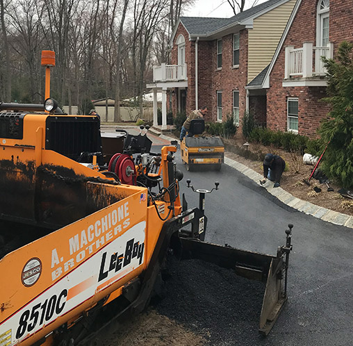 a macchione brothers employees working on large home driveway