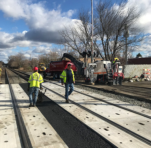a macchione brothers employees working on railroad asphalt