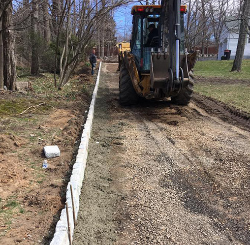 excavator working on driveway