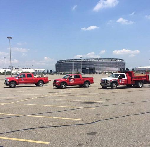 three red trucks in parking lot