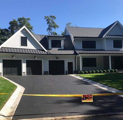 large home driveway with fresh asphalt