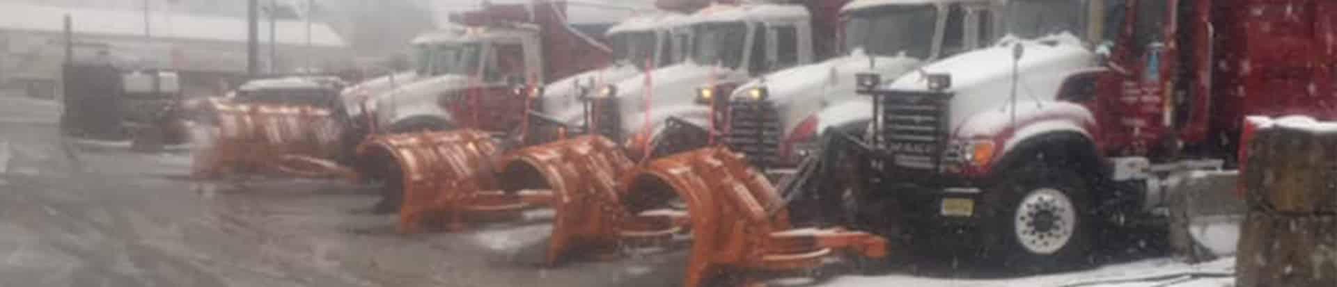 six snowplow trucks